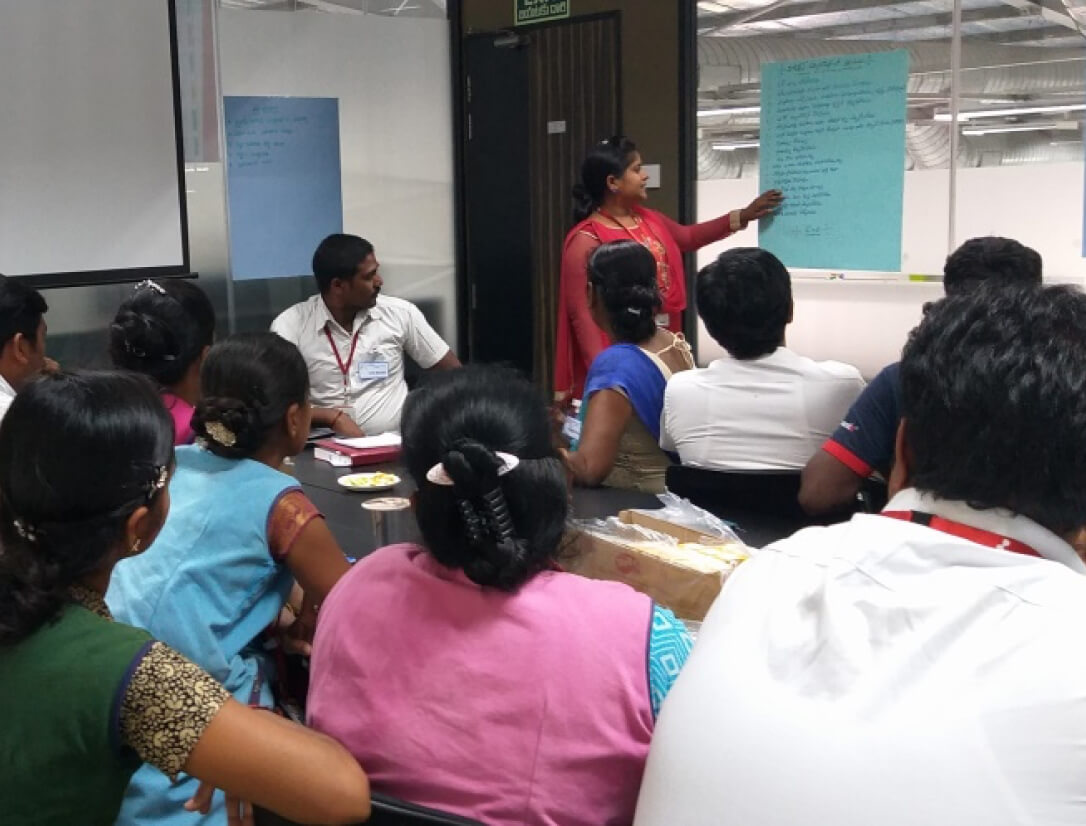 Supply chain workers engaged in a PVH Workplace Cooperation program training session