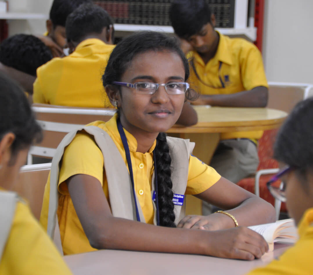 Divya in the school library when she was a Christel House student
