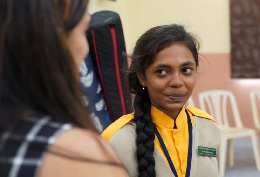 Soumya speaking to a PVH associate volunteer
